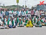 Farmers hold a roadblock protest for arresting KRRS leader