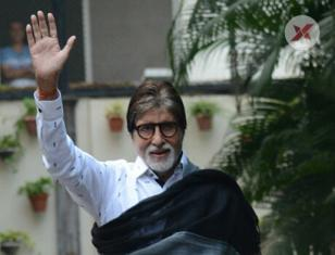 Amitabh Bachchan waves out to the fans outside his Residence