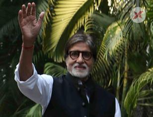 Amitabh Bachchan waves at his fans from his residence Jalsa in Mumbai