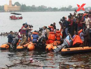 At least 12 dead and dozens missing from capsized Godavari tourist boat