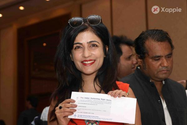 Celebrities Taking their royalty cheque during the royalty amount distribution worth Rs.13 crores