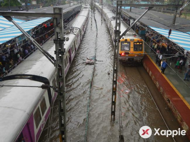 Hundreds of people stranded due to water logging at the Lokmanya Tilak Station in Mumbai
