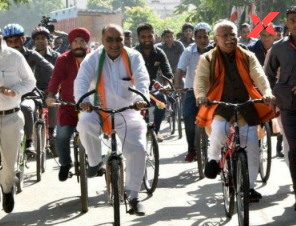 Haryana CM and JJP leader rides bicycle and tractor respectively to cast their votes